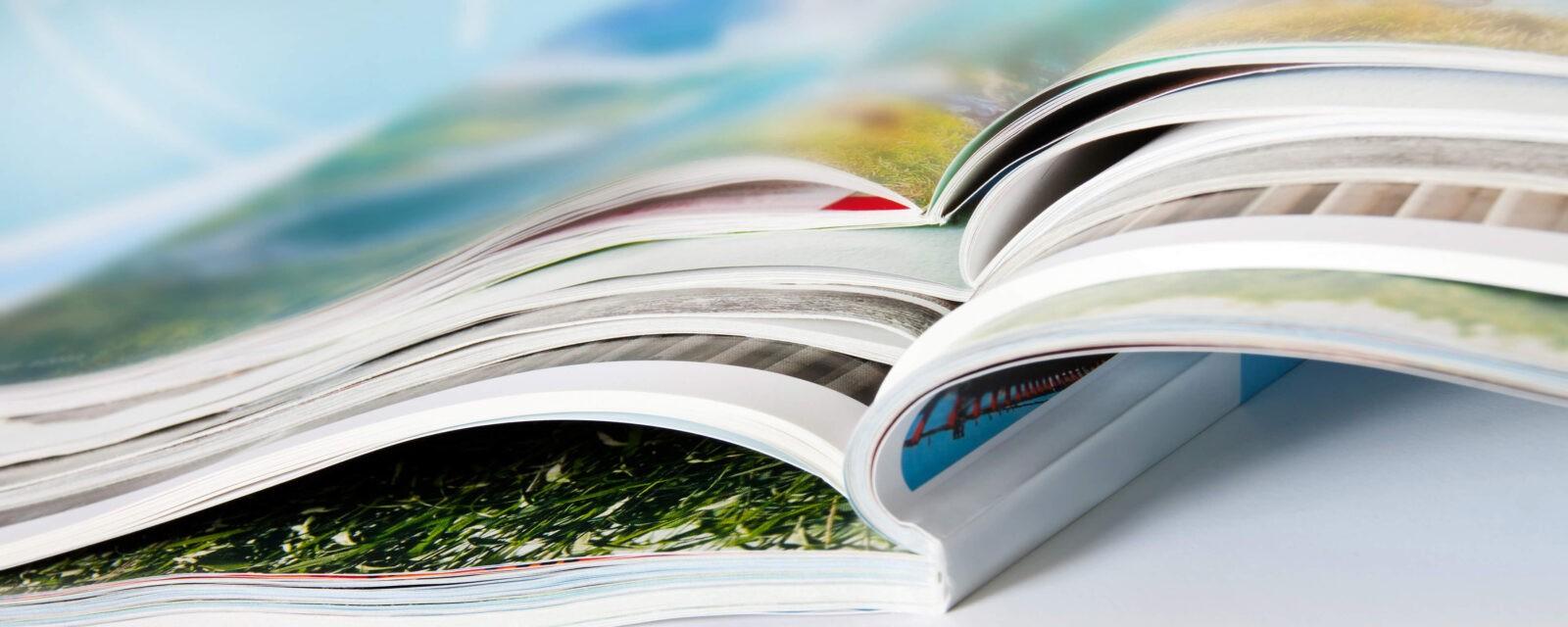 Banner - mehrere Magazine auf einander gestapelt